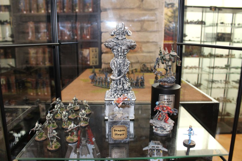 Miniatures from Tomas Pekar and Gloden Daemon statue in the back.