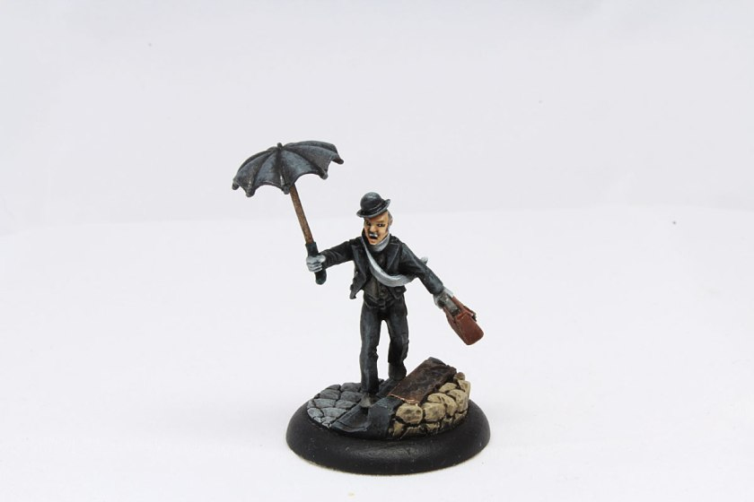 Butler with umbrella and suitcase.