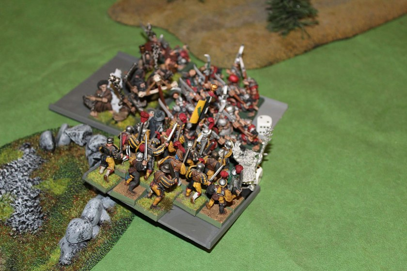 Swordsmen charge from the flank.