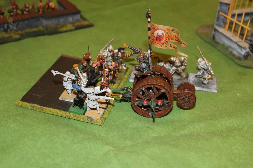 Ogres and Militia fighting Doomwheel.